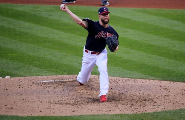 Indians starter Corey Kluber delivers a pitch in ALDS Game 2 by Arturo Pardavila III